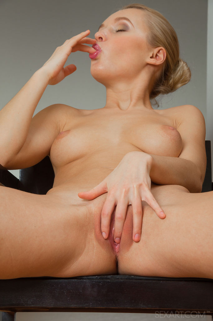 Naughty Blonde Babe Xena Masturbating