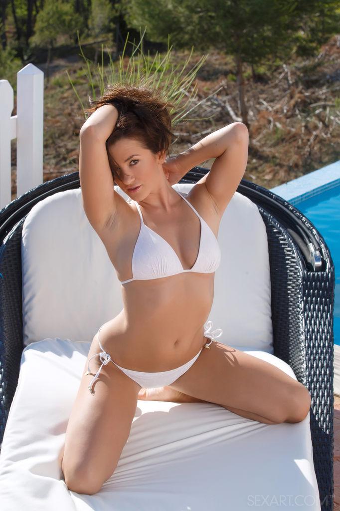 Sexy Tess B goes naughty at the pool